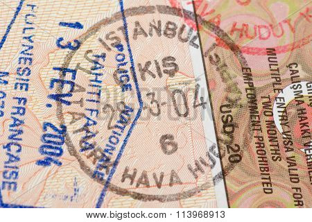 Passport page with Turkey visa and immigration control stamps.