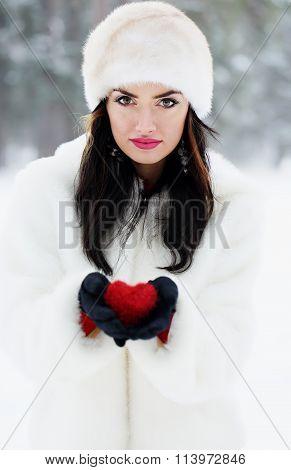 brunette holding red heart