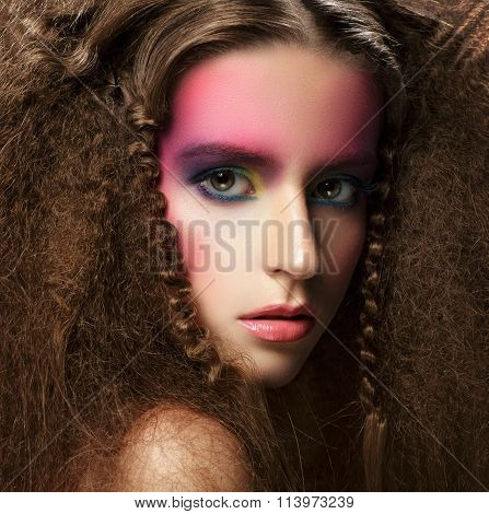 Portrait Of Young Woman With Creative Colorful Make-up And Hairstyle.