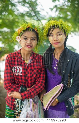 Young Myanmar girls with thanaka on her face is happiness