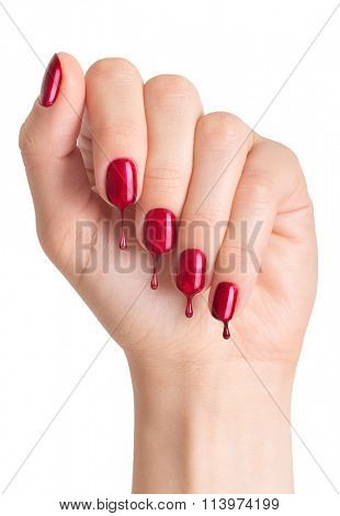 Female hand with painted nails. Nail polish dripping on nails
