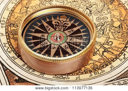 Old compass on vintage retro map