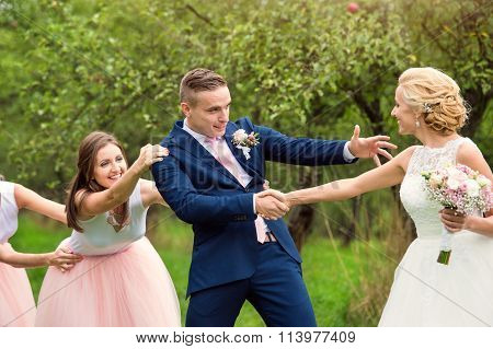 Beautiful wedding couple and bridesmaids