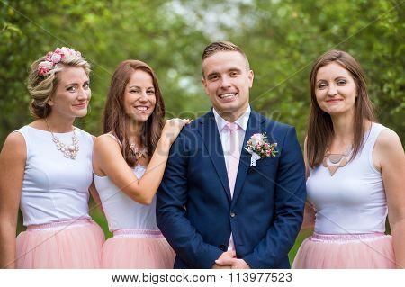 Bridegroom with bridesmaids