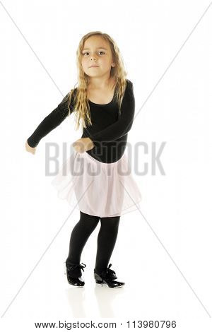 A cute kindergartner tap dancing with a twist and a tap.  On a white background.