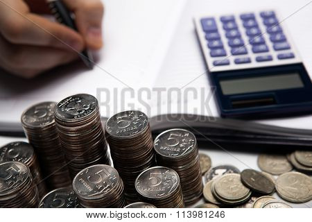 Stack Of Russian Coins On The Background Of Working As An Accountant