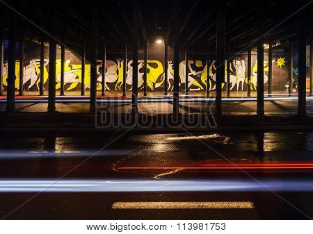 Vehicular Light Trails And graffiti On Background In The Night.