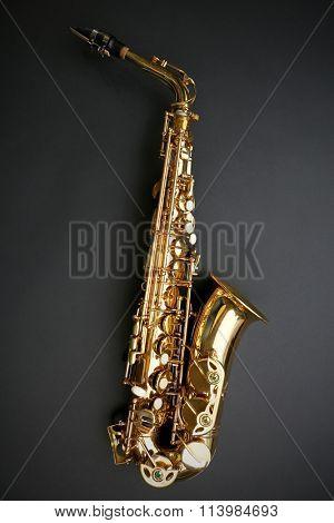 Beautiful golden saxophone on black background