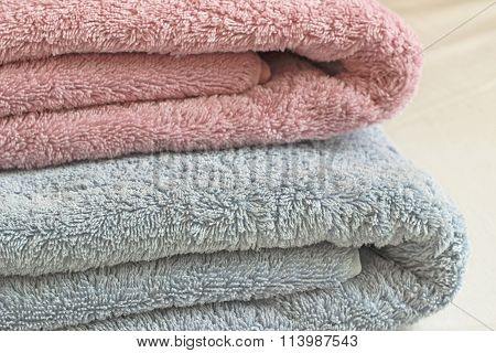 Two Towels On Simple White Bedsheet
