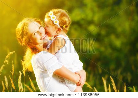 Happy Family On Summer. Little Girl Child Baby Daughter Hugging And Kissing Mother