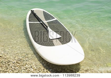 Paddle boarding equipment on the seashore