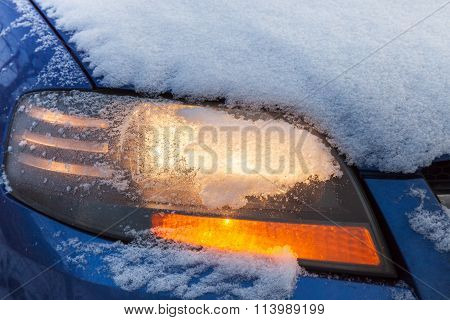 Car Headlight Flashing Under Snow