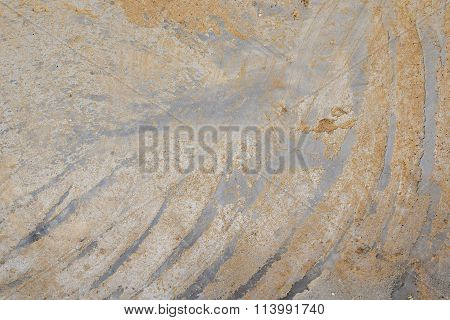Concrete With Dirty Diagonal Strokes On Cement