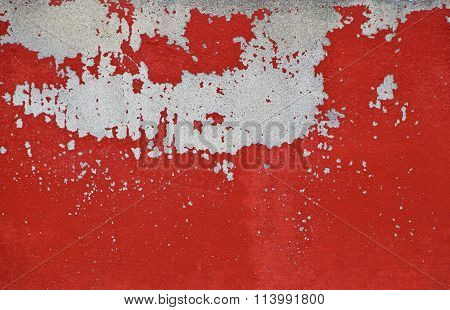 Flakes Of Old Red Paint On Grey Concrete Wall