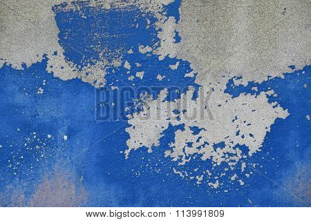 Flakes Of Old Blue Paint On Grey Concrete Wall