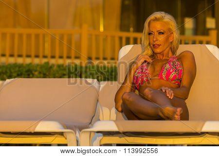 A bikini model posing at sunrise
