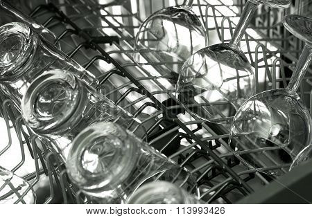 Open dishwasher with clean and shiny glasses