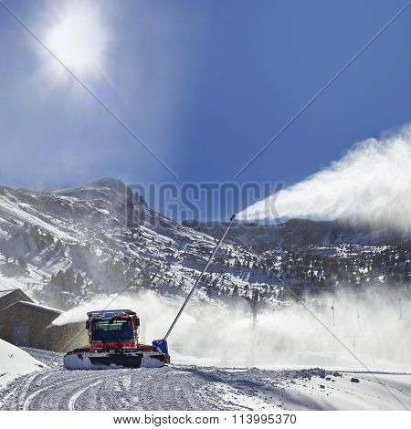 Red Snow Groomer In The Mountain