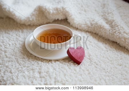 Closeup Of Cup Of Tea And Red Heart Figure