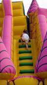 foto of childrenwear  - girl playing on a slide - JPG