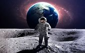Brave astronaut at the spacewalk on the moon. This image elements furnished by NASA. poster