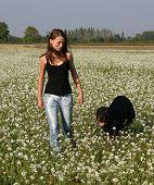 Girl And Black Dog