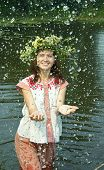 image of undine  - girl in russian traditional clothes playing into water - JPG