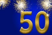 stock photo of 50th  - The numbers 50 in gold with fireworks on a blue background 50th anniversary - JPG