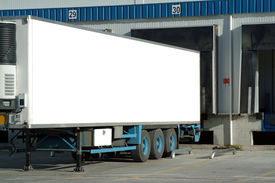 stock photo of tractor-trailer  - trailer of truck sitting at a loading dock - JPG