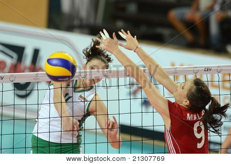 SZOMBATHELY, HUNGARY - JUNE 4: Zsanett Miklai (in red 9) in action at a CEV European League woman's volleyball game Hungary vs Bulgaria on June 4, 2011 in Szombathely, Hungary.