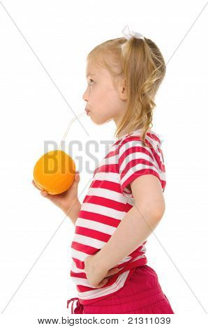 girl drinking orange juice through straw