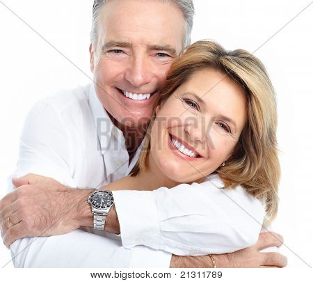 Senior smiling couple in love. Over white background.