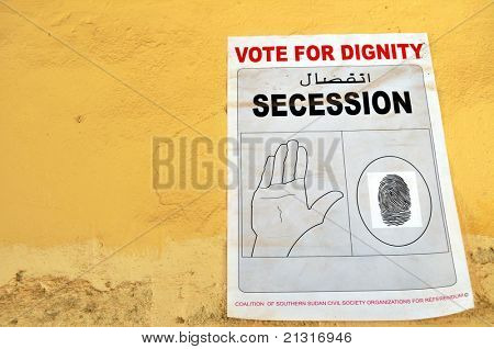 JUBA – JUNE 11: A poster remained on a wall in the capital Juba on June 11, 2011. Southern Sudan NGOs campaigned for secession ahead of a referendum for independence held in January 2011.