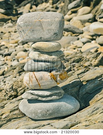 a strack of zen stones on a shingle beach