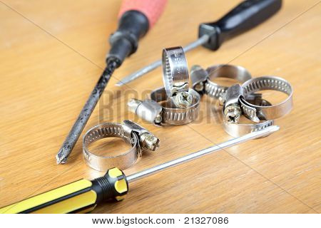 Screw-drivers And Clips For Hoses On A  Table