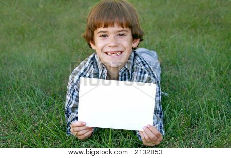 Boy With Blank Sign