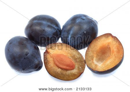 Three Plums And One Halved