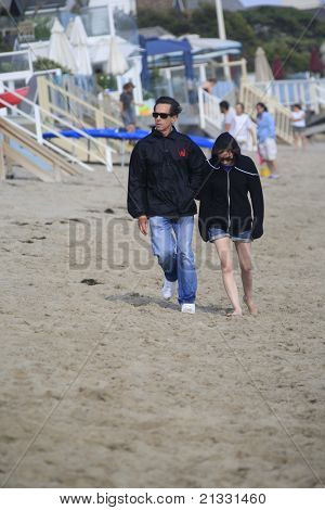 MALIBU, CA - AUG 26: Brian Grazer; his daughter on the beach in Malibu, California on August 26, 2007