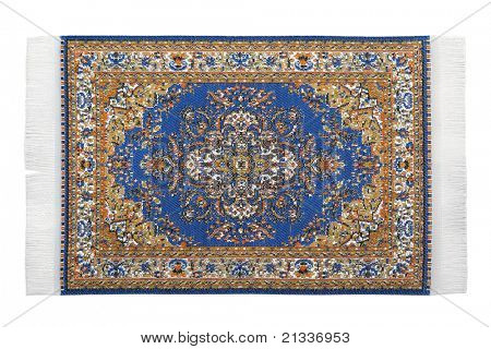 Rectangular turkish carpet horizontally lies on  white background