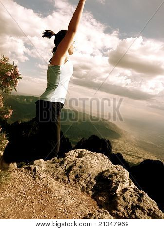 female athlete jumping toward sky