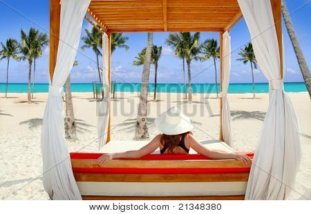 gazebo tropical beach with woman rear view looking sea from a tropical resort