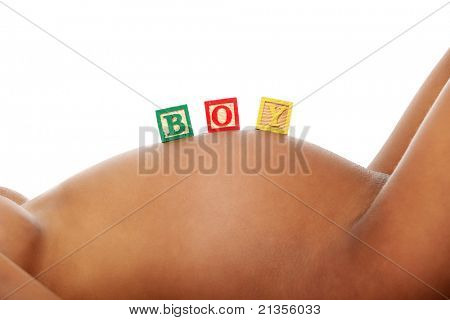 Word boy written with colorful alphabet cubes on pregnant belly