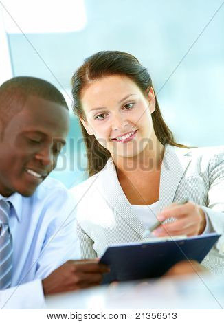 Portrait of successful partners discussing plan in office