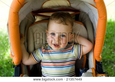 Happy Boy In The Baby Carriage