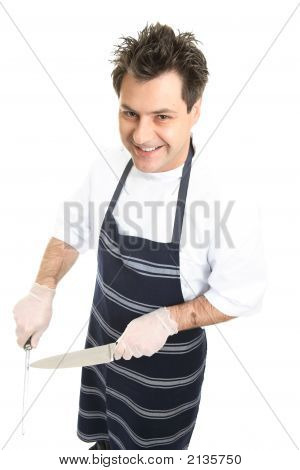 Smiling Butcher Or Chef Sharpens Knife