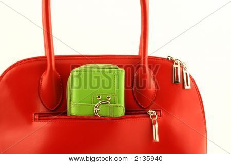 Green Wallet In Red Handbag'S Pocket