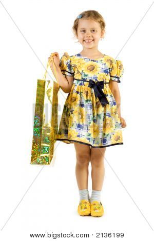 Little Smiling Girl With Shopping Bag.