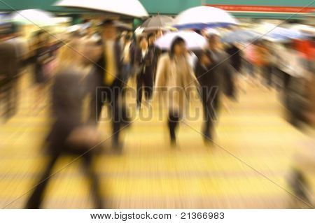 Busy street in Hong Kong, China. Purposely blurred with a lens.