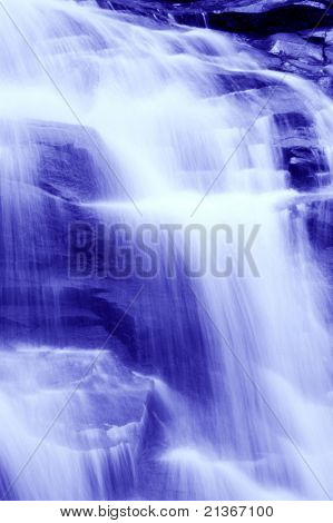 Monotone waterfall in tropical forest.