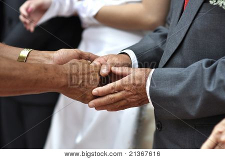 Hand shaking and welcoming guest during wedding day.